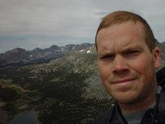 Self portrait on the Wolfs Head, Wind River Range, WY.