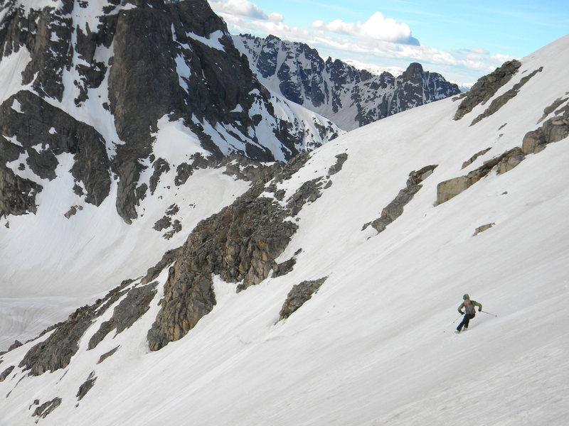 Chris Miller skiing the SE snowfield of Paiute in June.