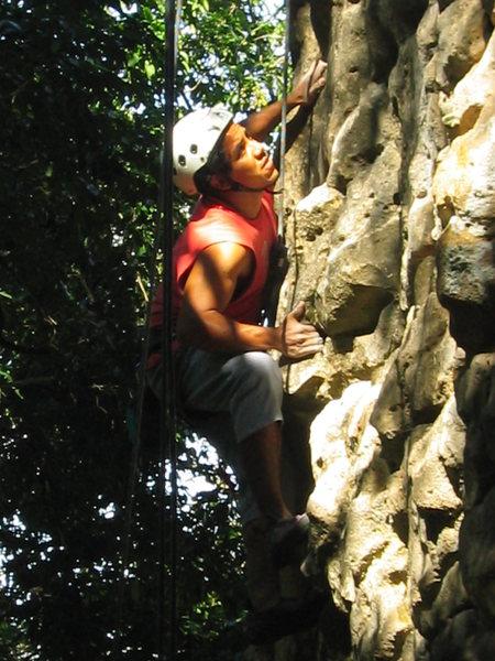C. Tapia climbing a route on La Piedrita.