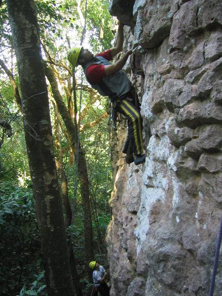 A. Aldama climbing a small overhang on La Piedrita.