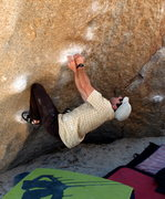 Rock Climbing Photo: Howie sets up for the dyno to the Hero Roof
