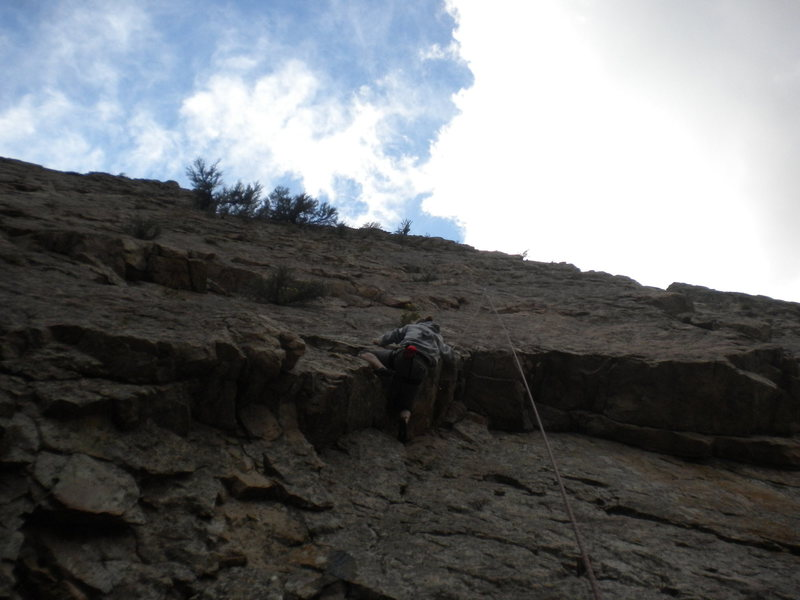 Melanie pulling the roof. The first bolt is on the upper face, a bit right of the rope