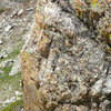 The last rap anchors after the downclimb through the gully. They blend in really well with the rock color....