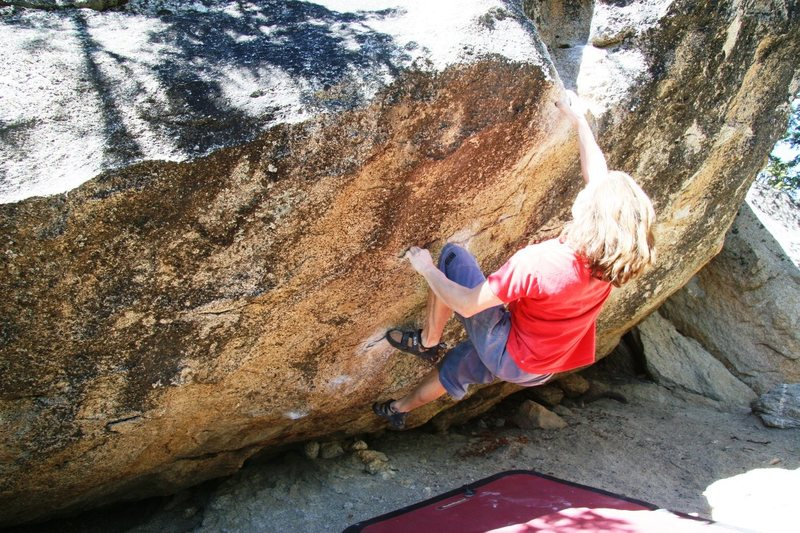 Moving through the crux sequence on Blue Flame.
