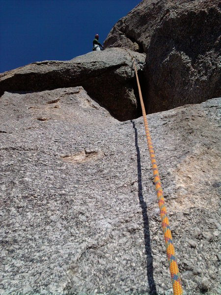 In this picture, the first off-width section can clearly be seen, with Cory belaying from the top of the second off-width, which cannot be seen here.