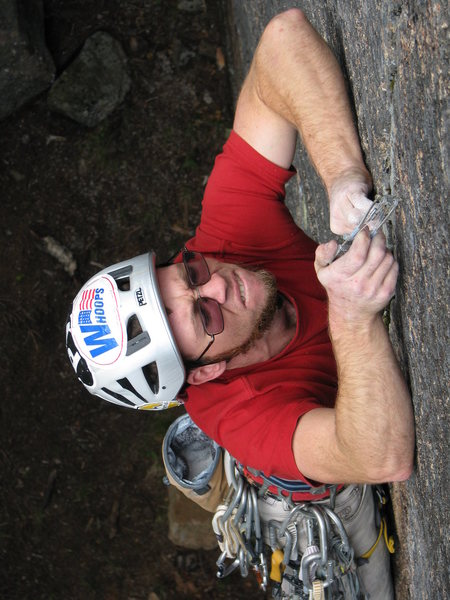 "Pat McElaney working the gear in on the excellent 11d/12a finger crack ""White Owl"""