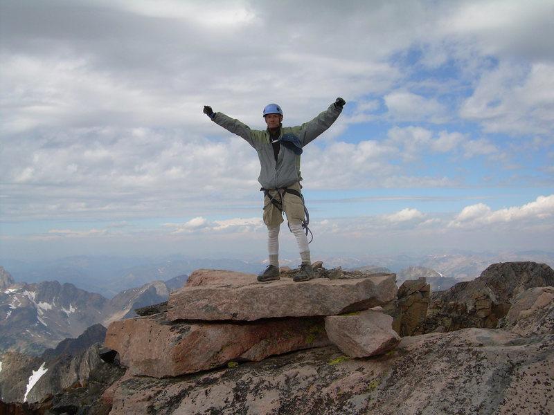 Standing atop Granite Peak's summit block
