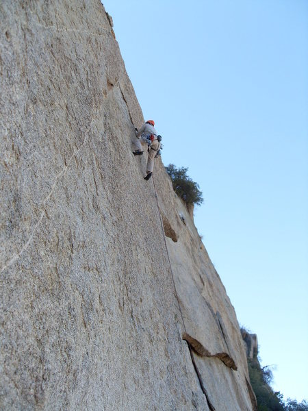 Leading the first left angling crack at the beginning of the route