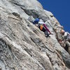 Protecting my girlfriend Ann as she steps around on the crux move for 'Left Ski Track' at Tahquitz Rock, CA