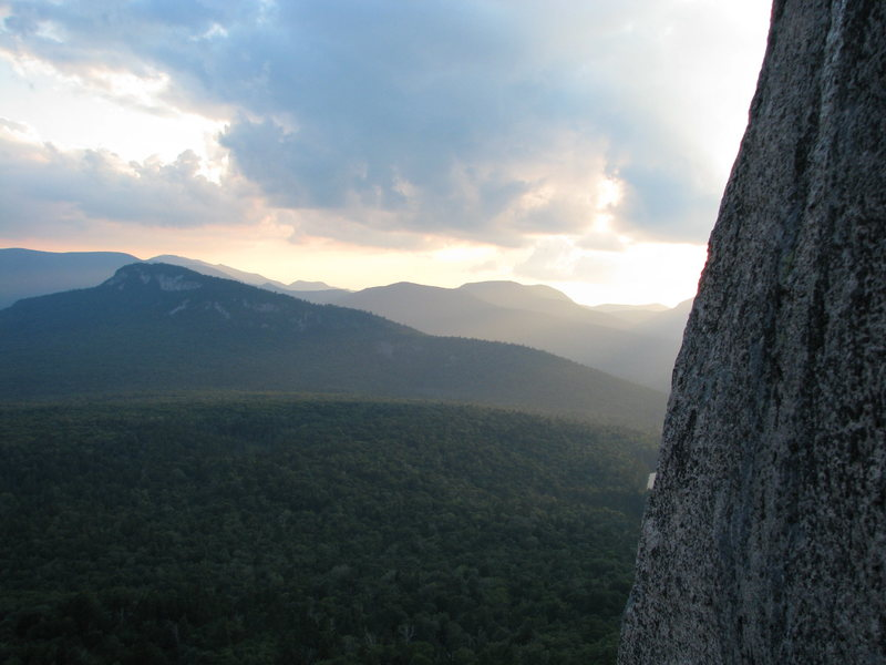 The view you get from the first belay of The RGC, looking towards Green's Cliff. The slabs of the Captain are on the mountain side just left of the sun.