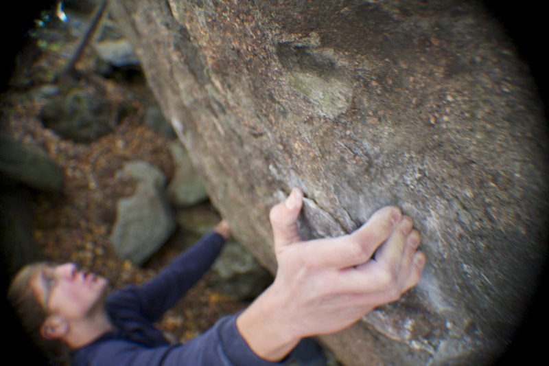 Nick Love taking a deep breathe before the crux big move on Shang-High Knights(V6)