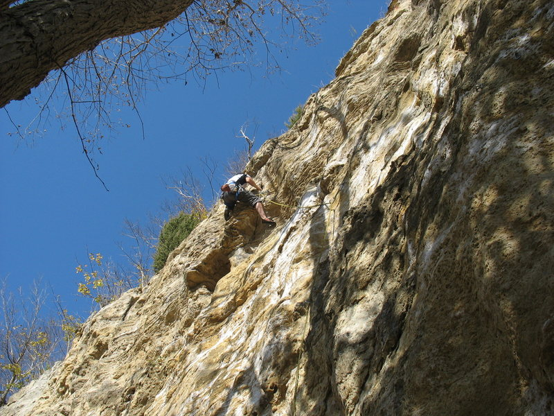 Dan pulling through the overhang near the top.