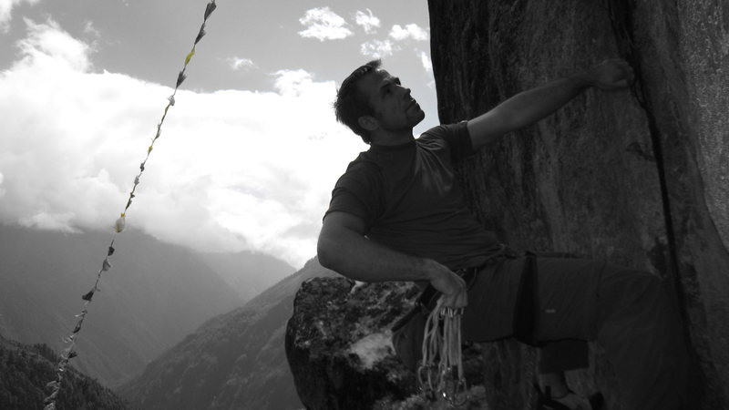 """Route above Namche Bazaar. Close to Sunshine Lodge boulder. Its the left hand route. Probably a 10b. Three bolts no anchors. You walk off. A @POUND@2 or a @POUND@3 cam goes well in the crack above the last bolt. If I was to name it it would be """"Mo mo Jam"""" 5.10b"""