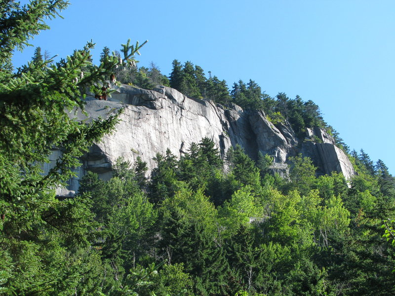 The Right Cliff- This cliff is hard to capture fully in a photograph, with mostly only the 5.10 Wall here showing. The approach gully angles up right to the left side of that wall, with the Contact Area low down and left, behind the trees and running up the gully. There is a large expanse of slab below the rock you can see here, up to 2 pitches tall, again, hidden mostly by the trees.