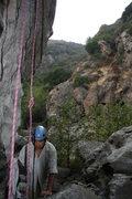 Rock Climbing Photo: Albert waiting out a short burst of rain.