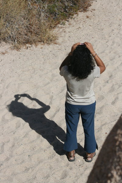 Veronica and her shadow taking a photo.