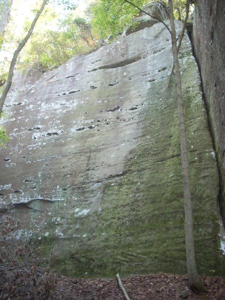 Climb the slab on the left.