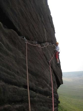 Nearing the end of the rising traverse on Legacy (photo by Phil Ashton)