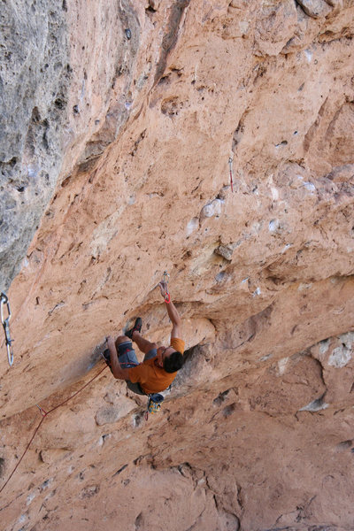 Setting up for the climactic dyno at the end of the hard climbing. Photo by Matt Moore