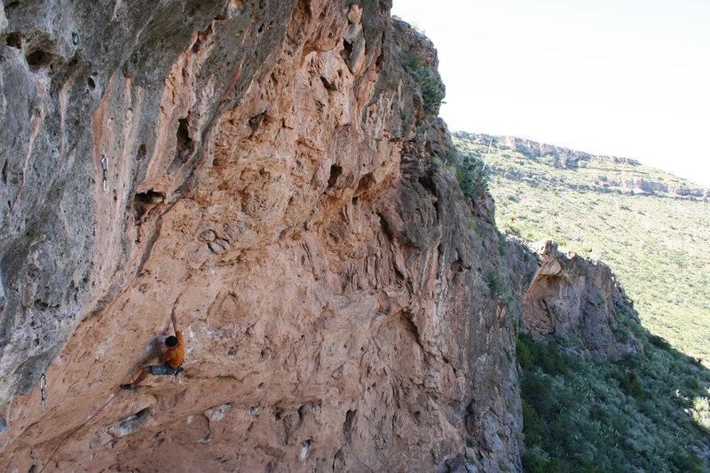 Working through the upper headwall on easier climbing. Photo by Matt Moore