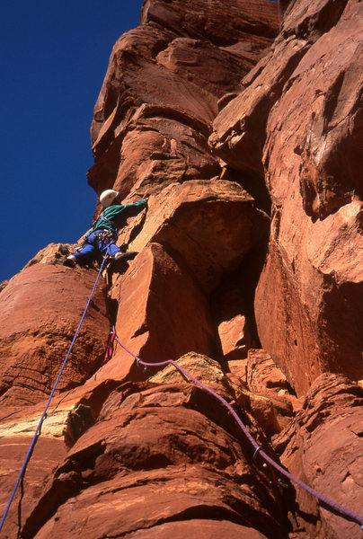Tomas turning the limestone band just below the first pitch belay stance.