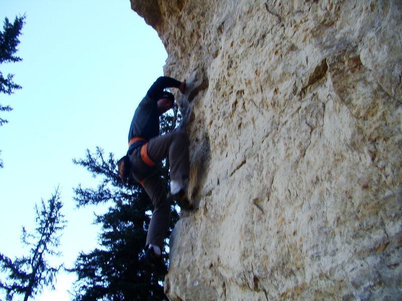 Looking for the two finger pockets after a bouldery start on The Tomahawk.