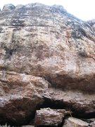 Rock Climbing Photo: Bottom Feeder starts atop the flat boulder, climbs...