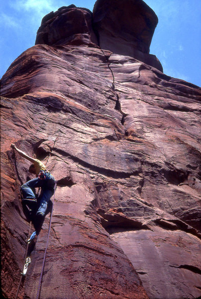 Jim Haisley on the lower section of pitch 2- he has surmounted the thin face start, and is in the better protected thin crack. The blank plaque above is where two aid moves were required to move right.