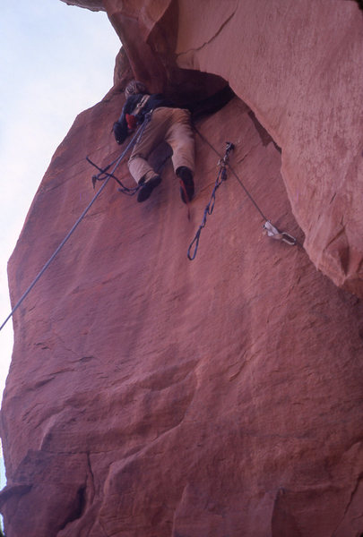 Karl Karlstom finally giving in and aiding the off width exit crack on Macita.