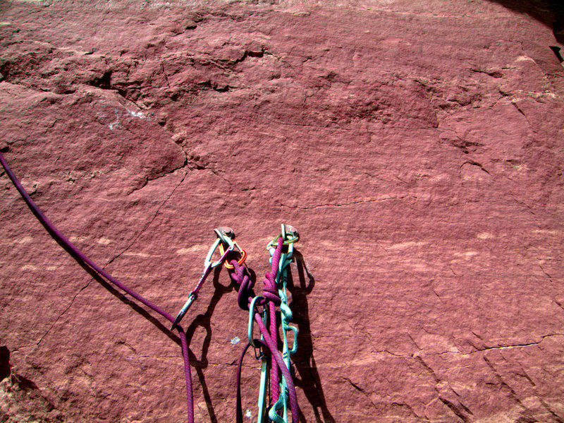 Not to be alarmist, but I noted the spiderwebbing series of hairline fractures that completely surround the closely spaced belay bolts- your sole security for starting the third pitch.