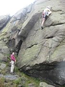 Rock Climbing Photo: The high step to gain the slab (photo by Neil Hyde...