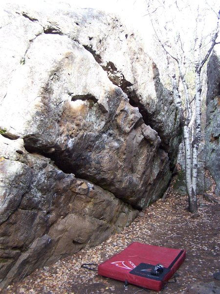 Anyone know any names/ratings  for the problems on this boulder? There are several fun ones including a traverse along the top horizontal crack.