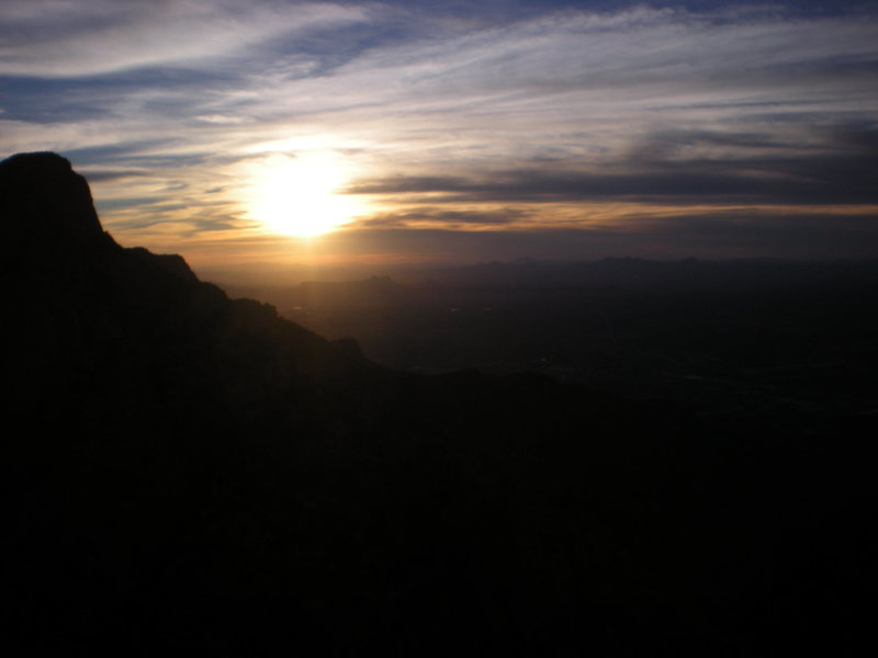 sunset from the summit.  i think that's table mt. at left.  put that camera away and let's go find the raps!!