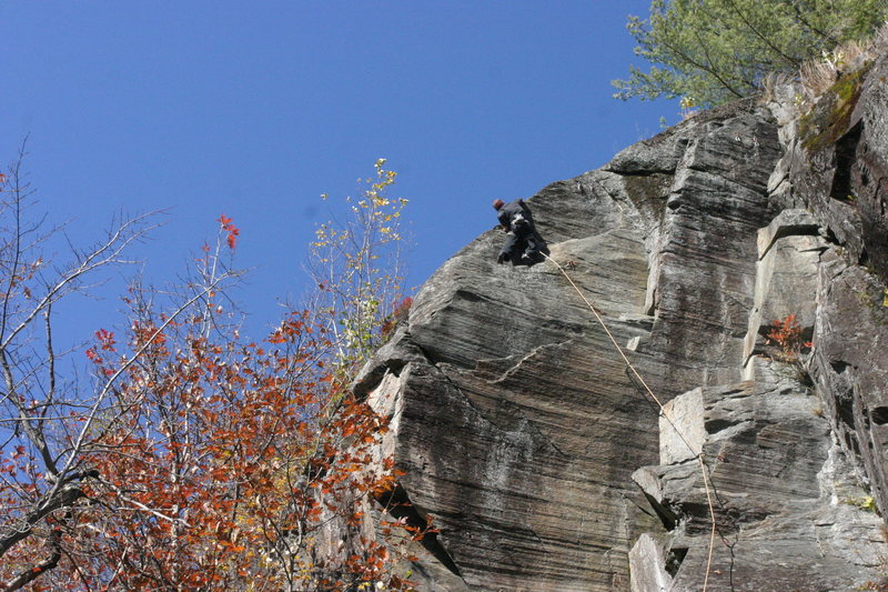 Climber (Chris from NY?) finding the good holds on top of the arete to clip the anchor