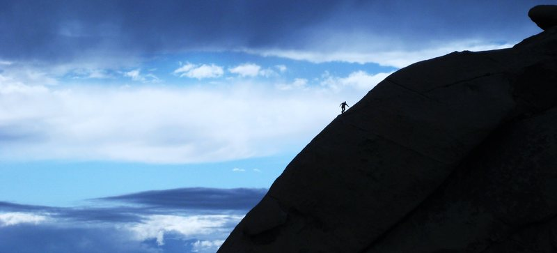 Climber topping out on Swept Away.<br> <br> photo by bob gaines