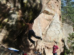 Rock Climbing Photo: Mike B sticks the dynamic move to the juggy hueco.