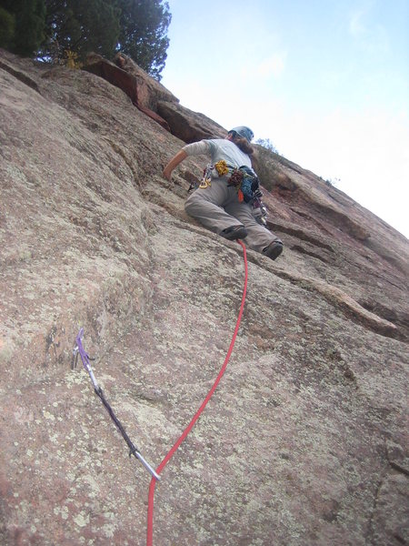 Heather begins leading up the runout Cracker Jack route.