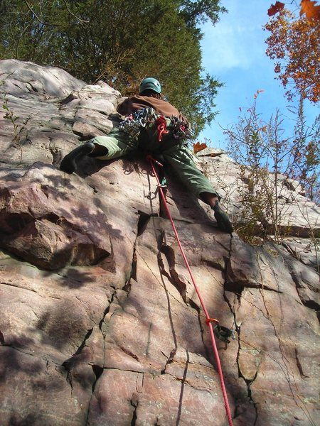 Starting moves of route Tom at Mousehole Buttress.  Dylan leading.
