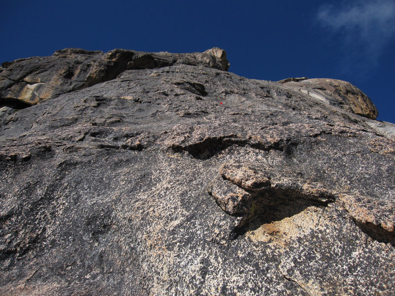 Looking up at the second pitch from the first belay@SEMICOLON@ the first bolt is marked with a red 'X'.