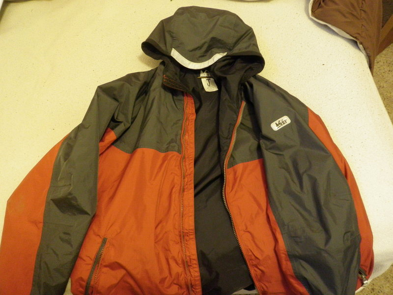 REI Youth XL Rain Jacket. Same size as an Adult Small. Good condition.
