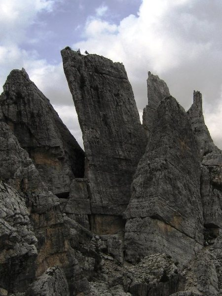East aspect of Torre Quarta Alta.  <br> <br> To the right is Torre Quarta Bassa, to the left is Torre di Mezzo.  Just behind the Torre Quarta formation, one can see the spiny thin summit of Torre Inglese.