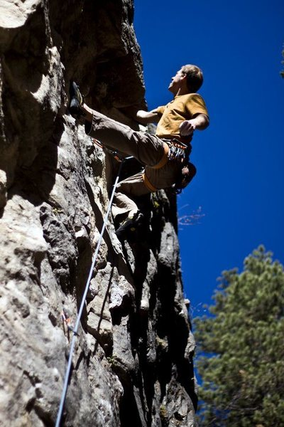 Pulling the micro-roof on Doorf.<br> Be sure to flex, grunt and make the face or else the move doesn't count.<br> This is a really fun route. Go get some!<br> <br> Photo by Laura Heisinger