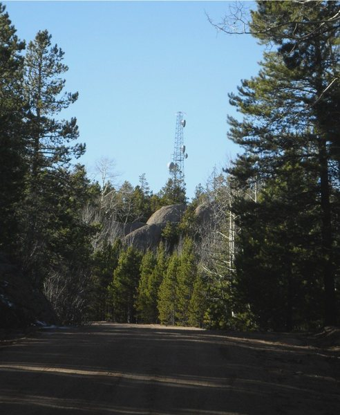 Driving north on Rampart Range road, this microwave tower will come into view just before you need to turn right onto 327.  This picture was taken looking north along Rampart Range road.  To get to Parachute Rock, turn right (east) here onto 327.