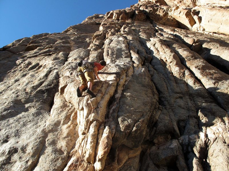 Me just before clipping the econd bolt bolt.The route then goes left into the dihedral.