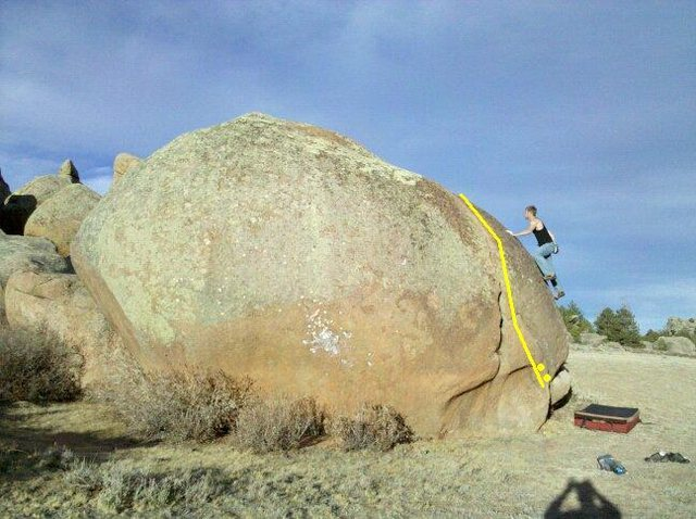 """Yellow line indicates problem path. Note: climber is seen on """"V1 Slab."""""""