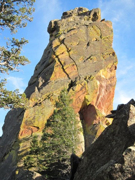 The North Face of the North Summit of Jamcrack Spire.  The route 'Center One' (10a) follows the obvious, sunny, left-facing corner to cracks, and 'Right For Grapenuts' follows the arete just left, dividing sun and shade.  Left Crack ascends a curving crack on the shaded North Face.