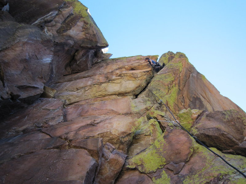 Seth pauses and contemplates the bulging crux on P2 of Fear Of Flying (5.10).
