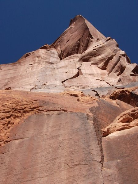 Raven follows the wandering crack system on the right side of the tower. the crux of the route is the visible flake at the top of the photo.
