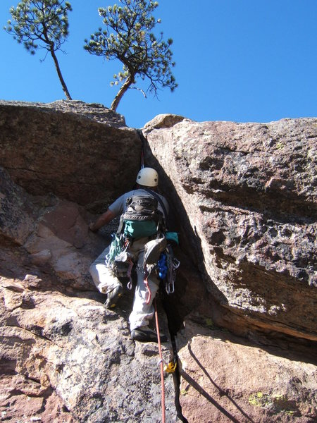 Greg Bloomberg arranges protection for the crux move just above.