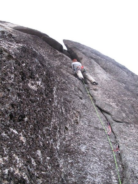 Leading up the second pitch crack. Tight squeeze through the chimney at the top!